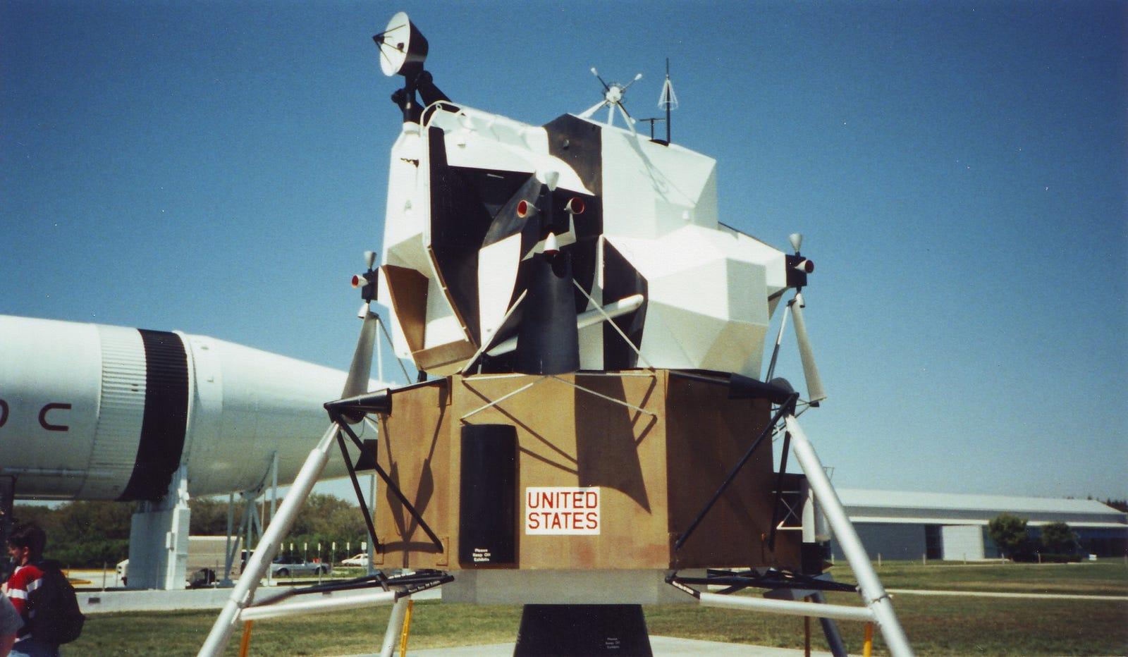Lunar Lander replica in the KSC Rocket Garden. In the background is a Saturn 1B
