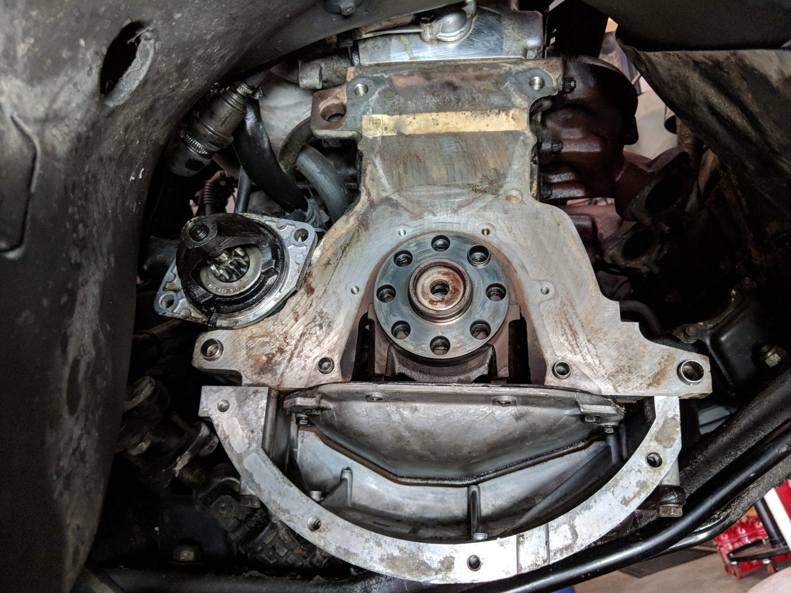 The rear main seal carrier removed from the engine.