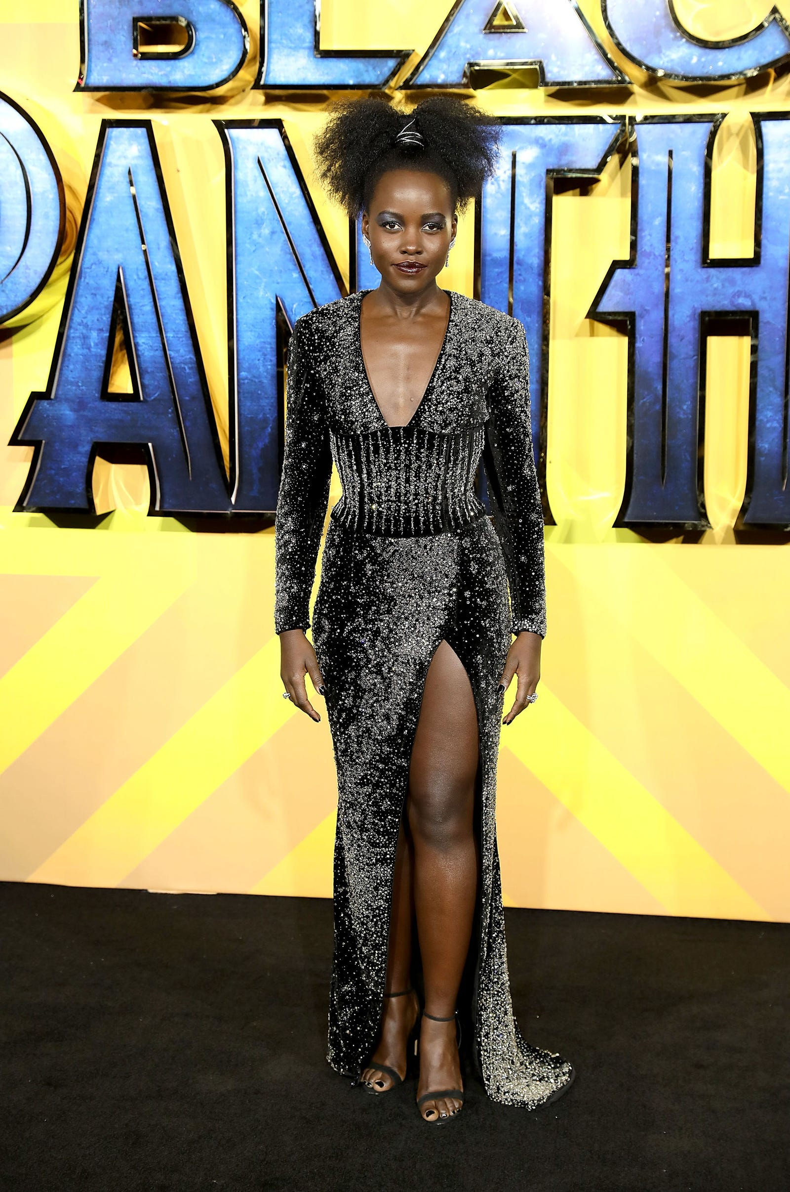 Lupita Nyong'o rocks rough and tough in her Afro-puff ... paired with shimmer, of course. (Tim P. Whitby/Tim P. Whitby/Getty Images)