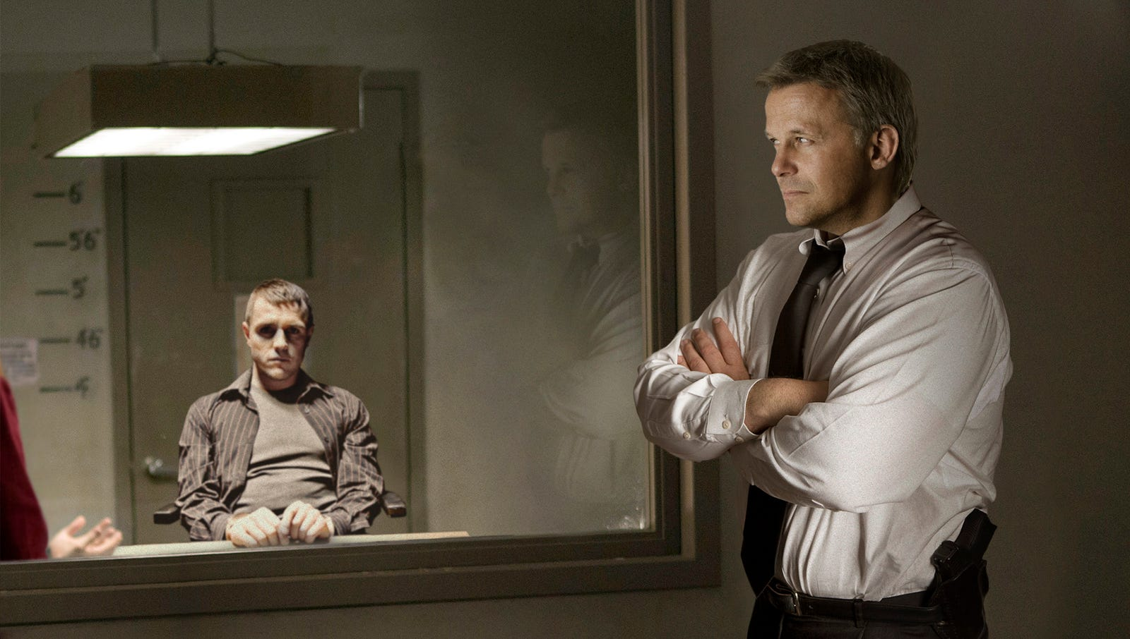 Detective Behind Two-Way Mirror Nervously Crosses Arms As Criminal Addresses Him Directly