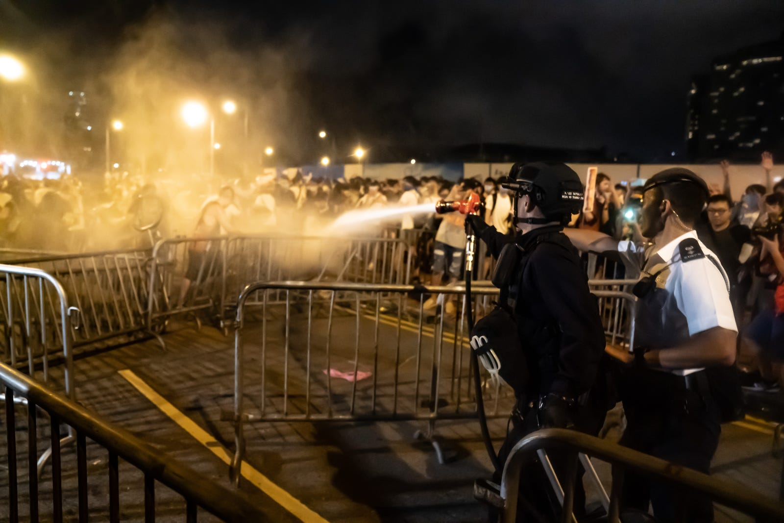 A police officer uses pepper spray during a clash at Legislative Council after a rally against the extradition law proposal at the Central Government Complex on June 10, 2019 in Hong Kong.