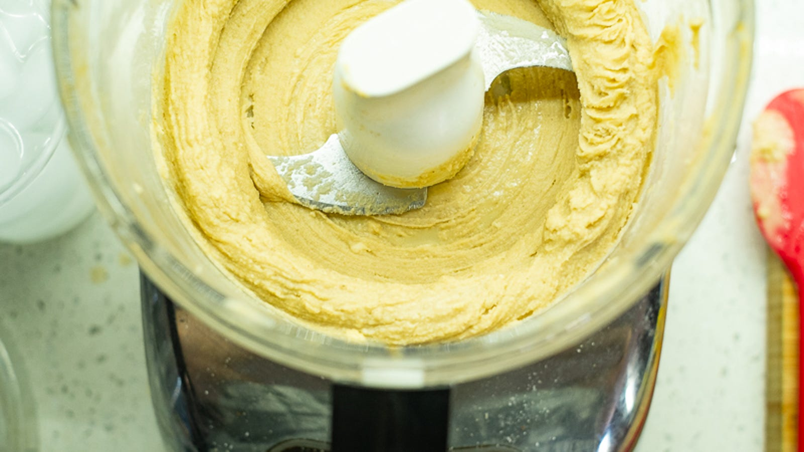 The tahini gets sludgy when blitzed with the lemon-garlic-cumin mixture...
