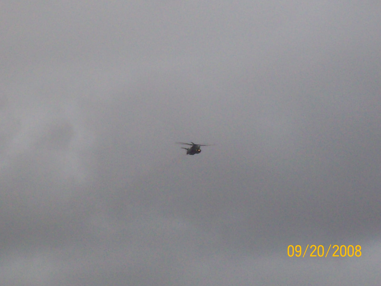 A CH-53E Sea Stallion flying over the crowd.