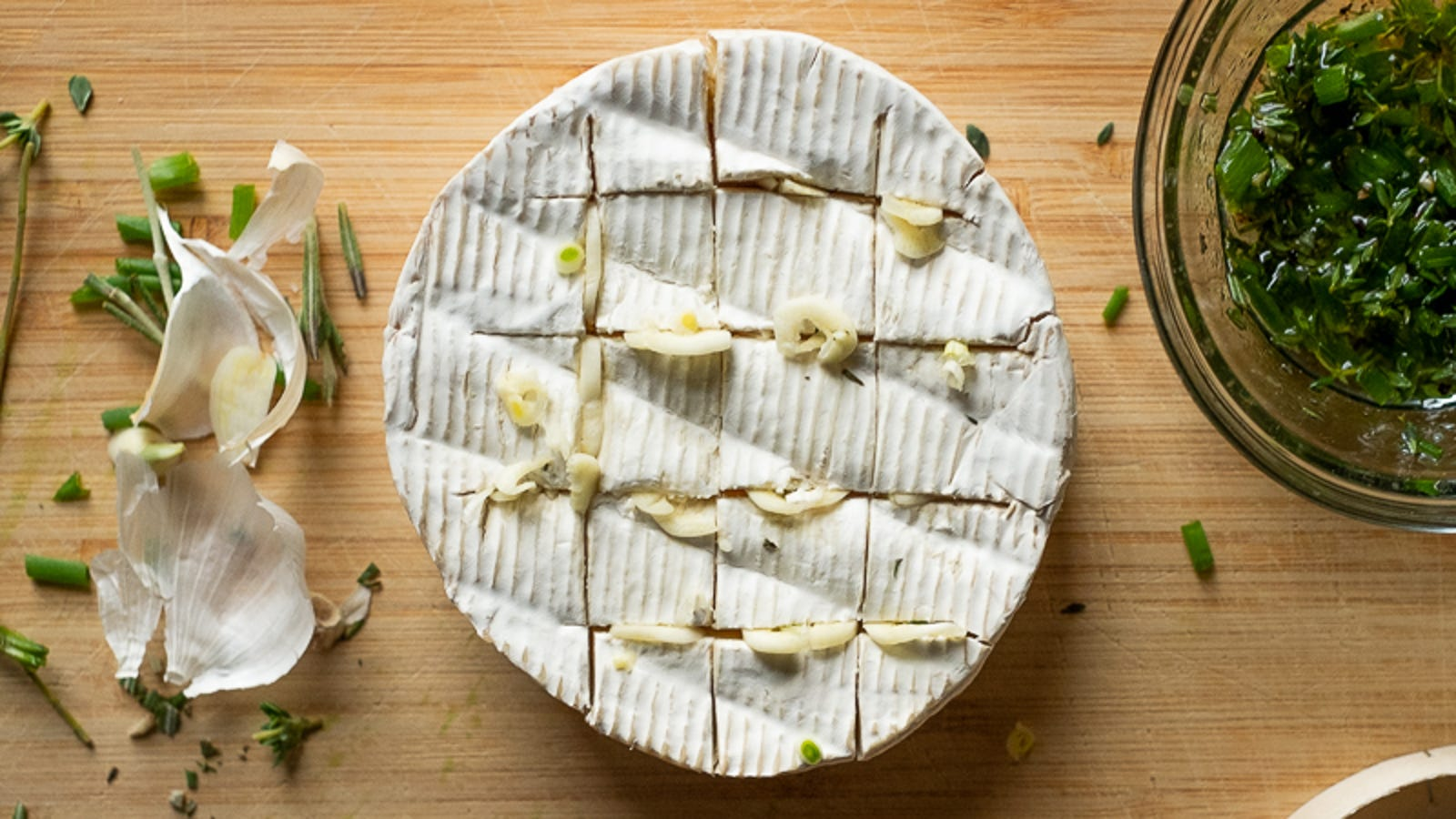 Slide sliced garlic right into the slits.