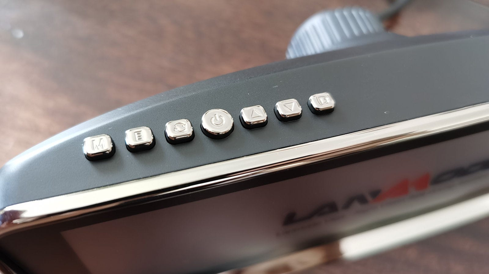 A close-up of the buttons to adjust the image on the screen.