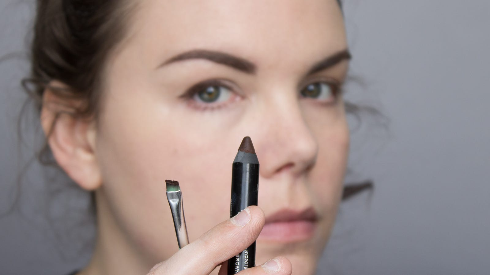 """If your only brown """"pencil"""" eyeliner is super chubby or you can't find a sharpener, use an angled brush to help clean up lines. (I used an Essence angled eyeliner brush and a Rimmel Scandal'eyes eyeshadow stick in """"Bootleg Brown."""")"""
