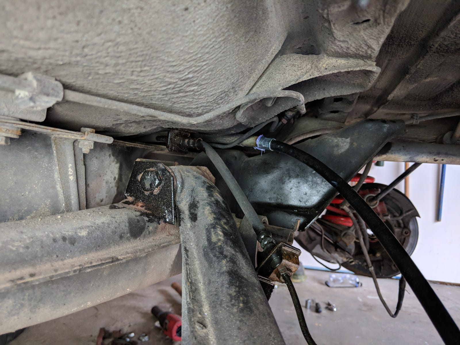 The rubber brake hose (center) is looking worse for wear. The new parking brake cable (right) looks good though!