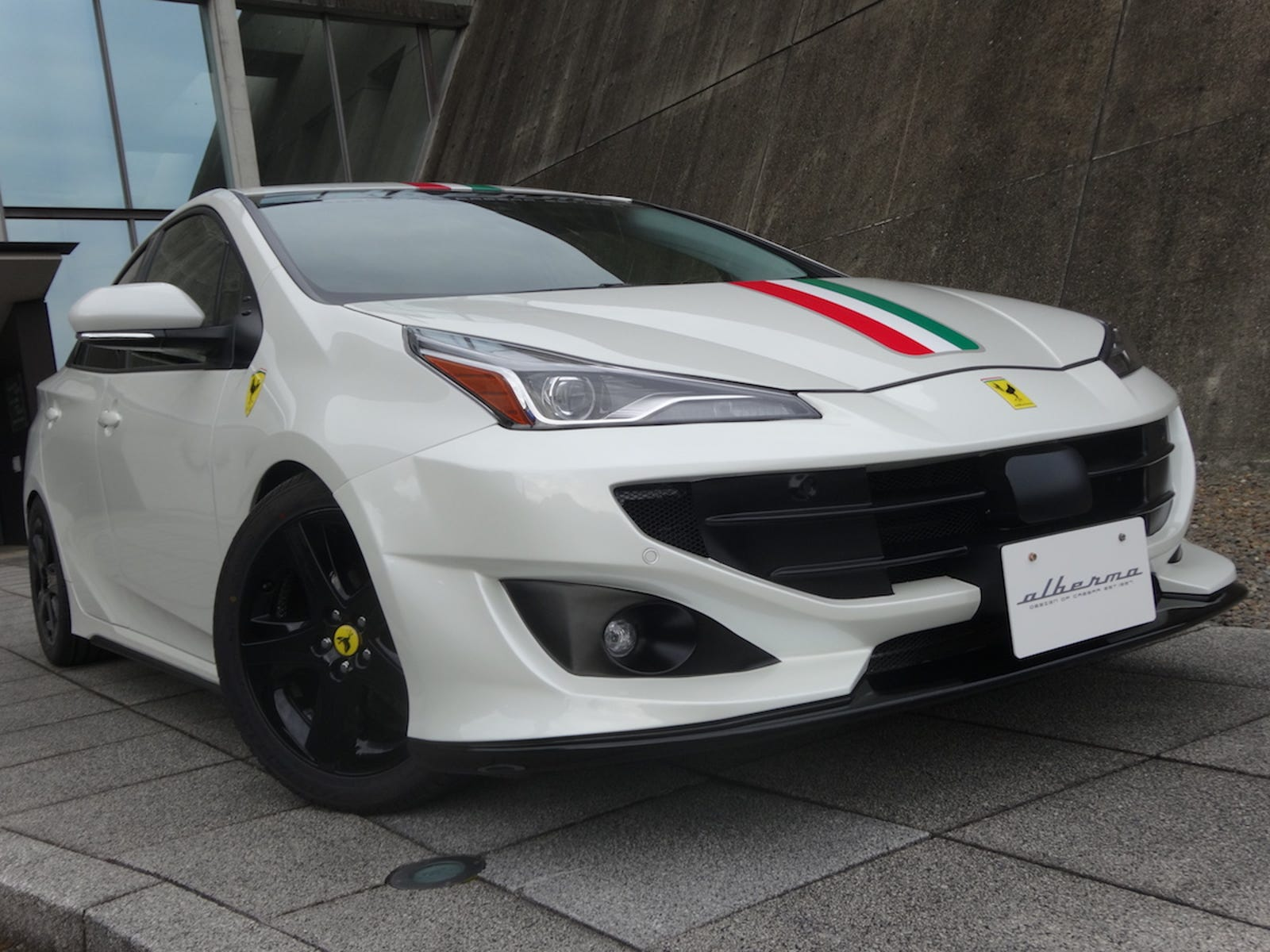 Illustration for article titled The 2020 Toyota Prius Actually Looks A Lot Better With This Fake Ferrari Bodykit