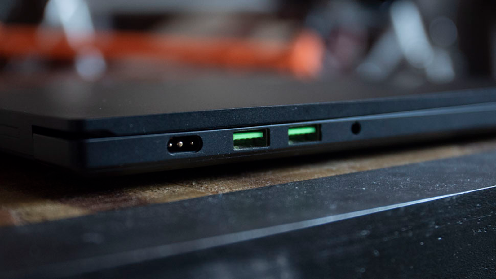 That power port is irritating, but necessary according to Razer.