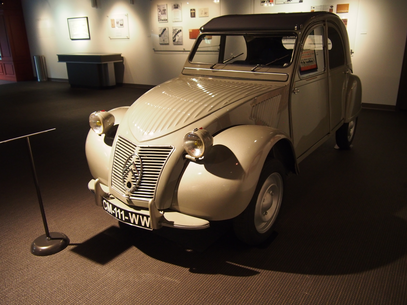 A beautifully restored 1952 Citroën 2CV with its distinctive early ripple bonnet.
