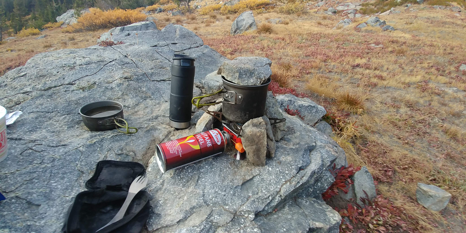 I was trying to get creative to block the wind from stove as well as keeping the heat in my pot to boil water faster. The smaller pot used as a lid still proved to be more efficient than a rock of course but I figured I would give it a try. Dinner was a nice warm reward for the day again.