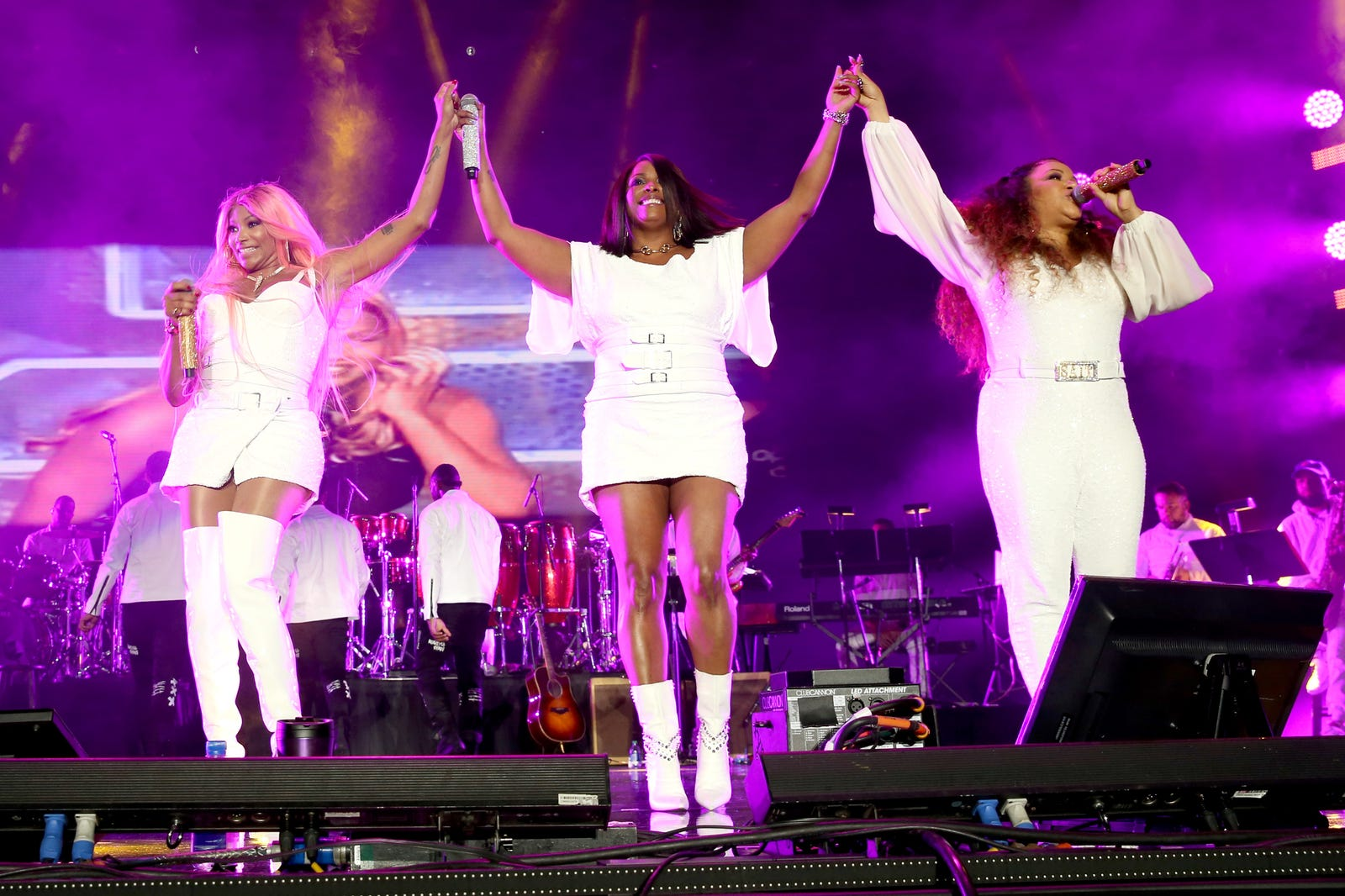 Sandra Denton, left, DJ Spinderella and Cheryl James of Salt-N-Pepa perform onstage during the 2018 Essence Festival presented By Coca-Cola, Day 2 at Louisiana Superdome on July 7, 2018 in New Orleans, Louisiana.