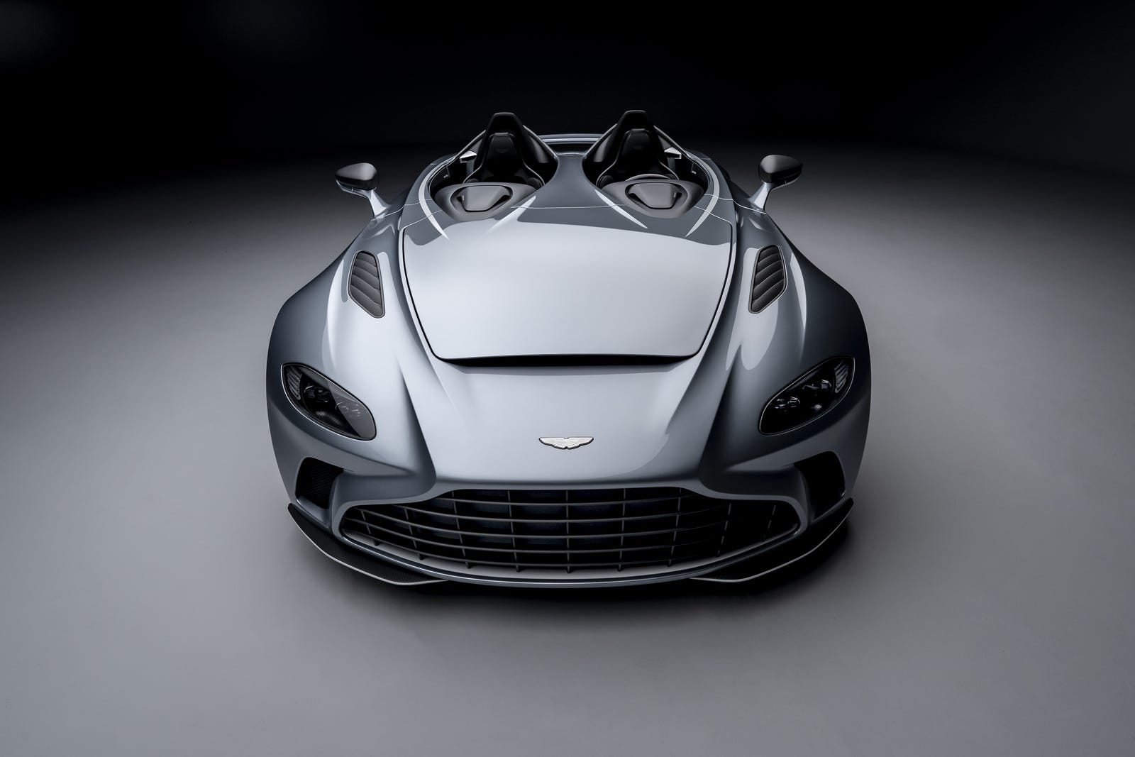 Illustration for article titled We Want You To Buy The Aston Martin V12 Speedster And We Want You To Suffer