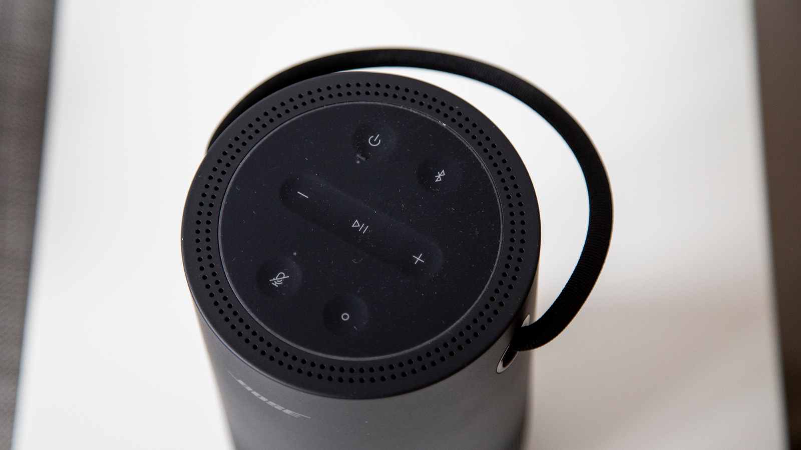 The top of the Bose Portable Home Speaker has many buttons.