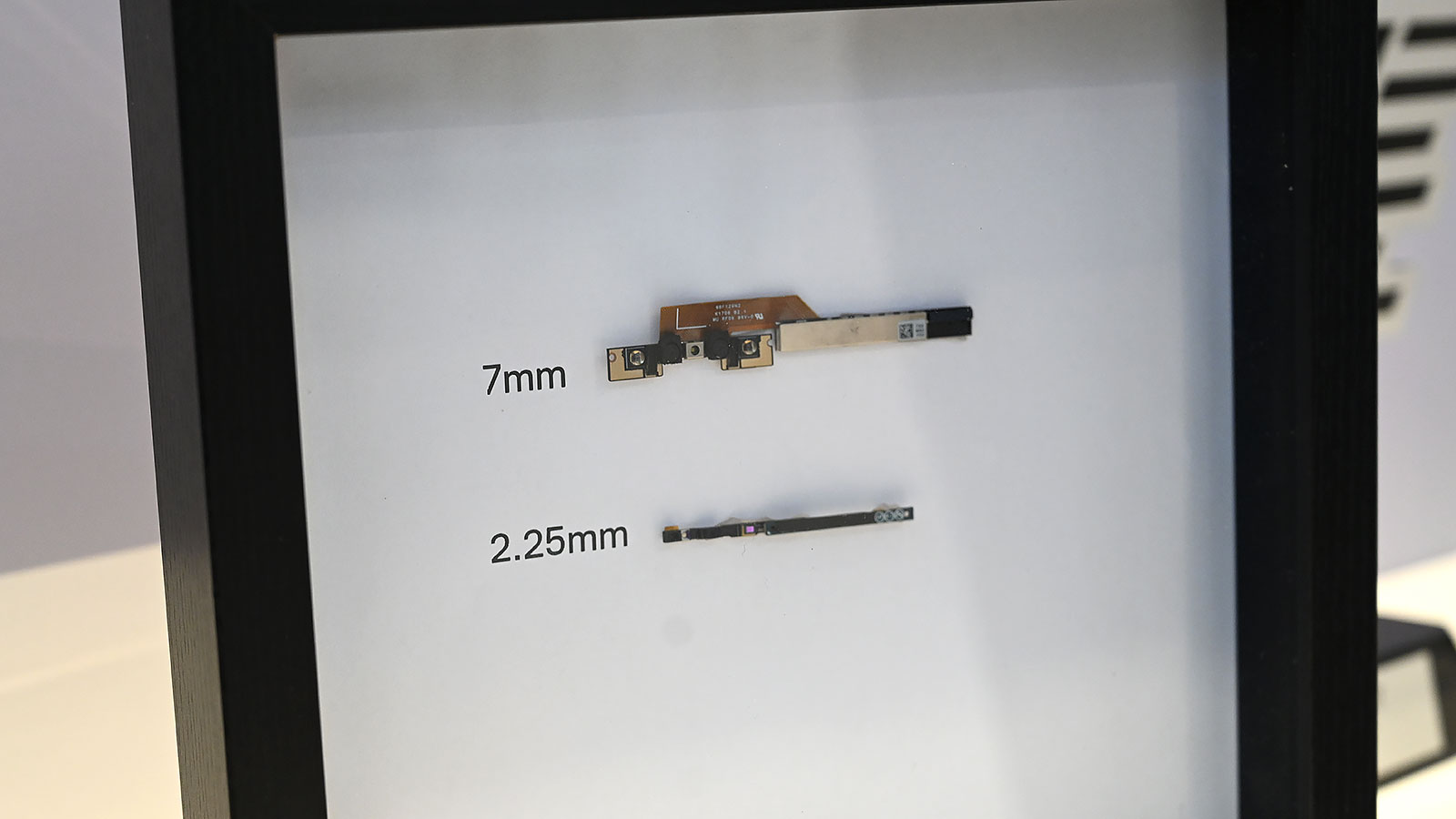 Here's a size comparison between the old XPS 13's chin webcam, and the new models micro HD webcam.