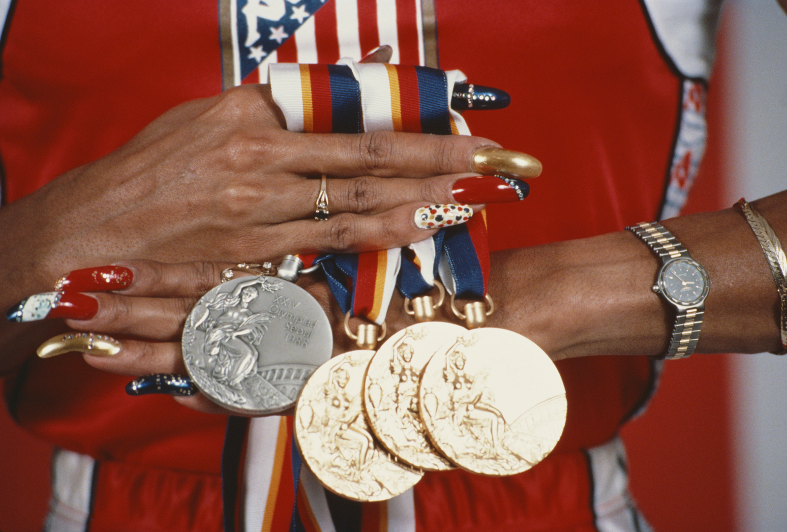 Florence Griffith Joyner nails it at the 1988 Olympic Games. (Tony Duffy/Allsport via Getty Images)
