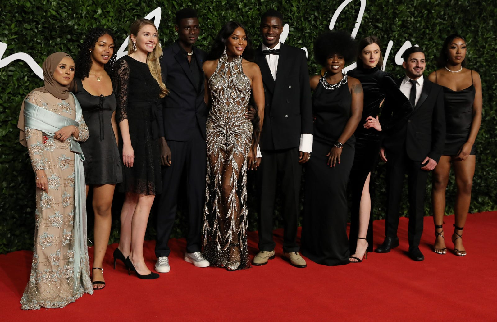 Naomi Campbell, center, and guests