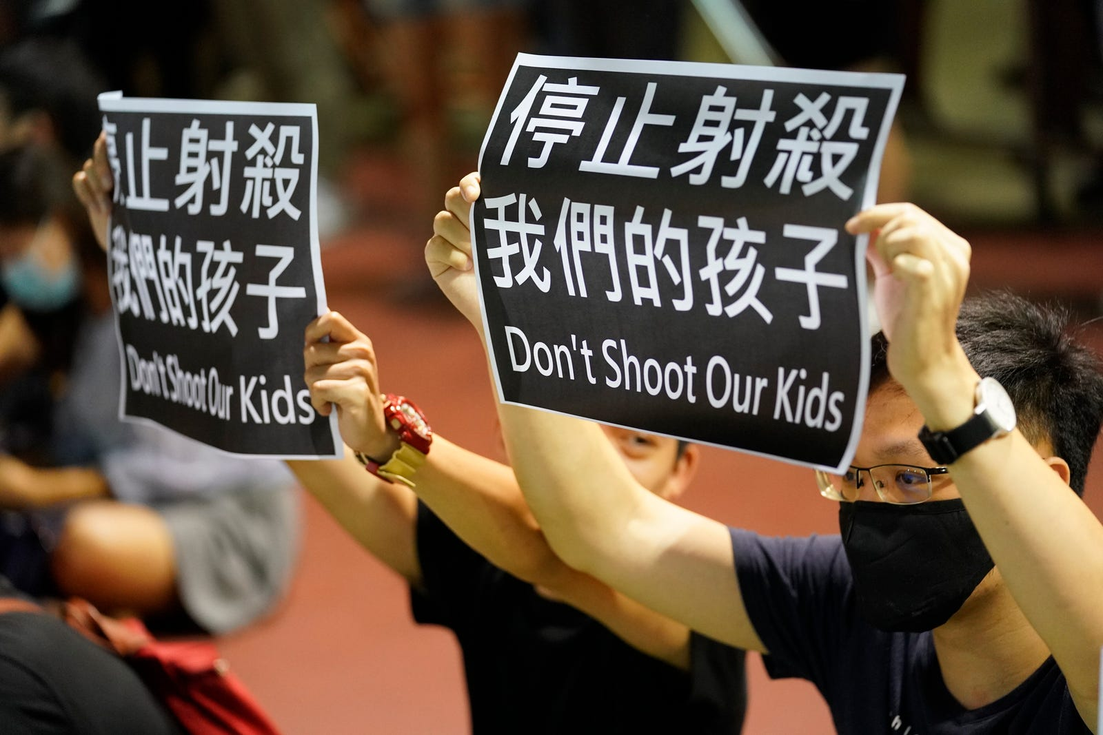 Residents of Tsuen Wan gather at an open air stadium to protest a teenage demonstrator shot at close range in the chest by a police officer in Hong Kong, Wednesday, Oct. 2, 2019.