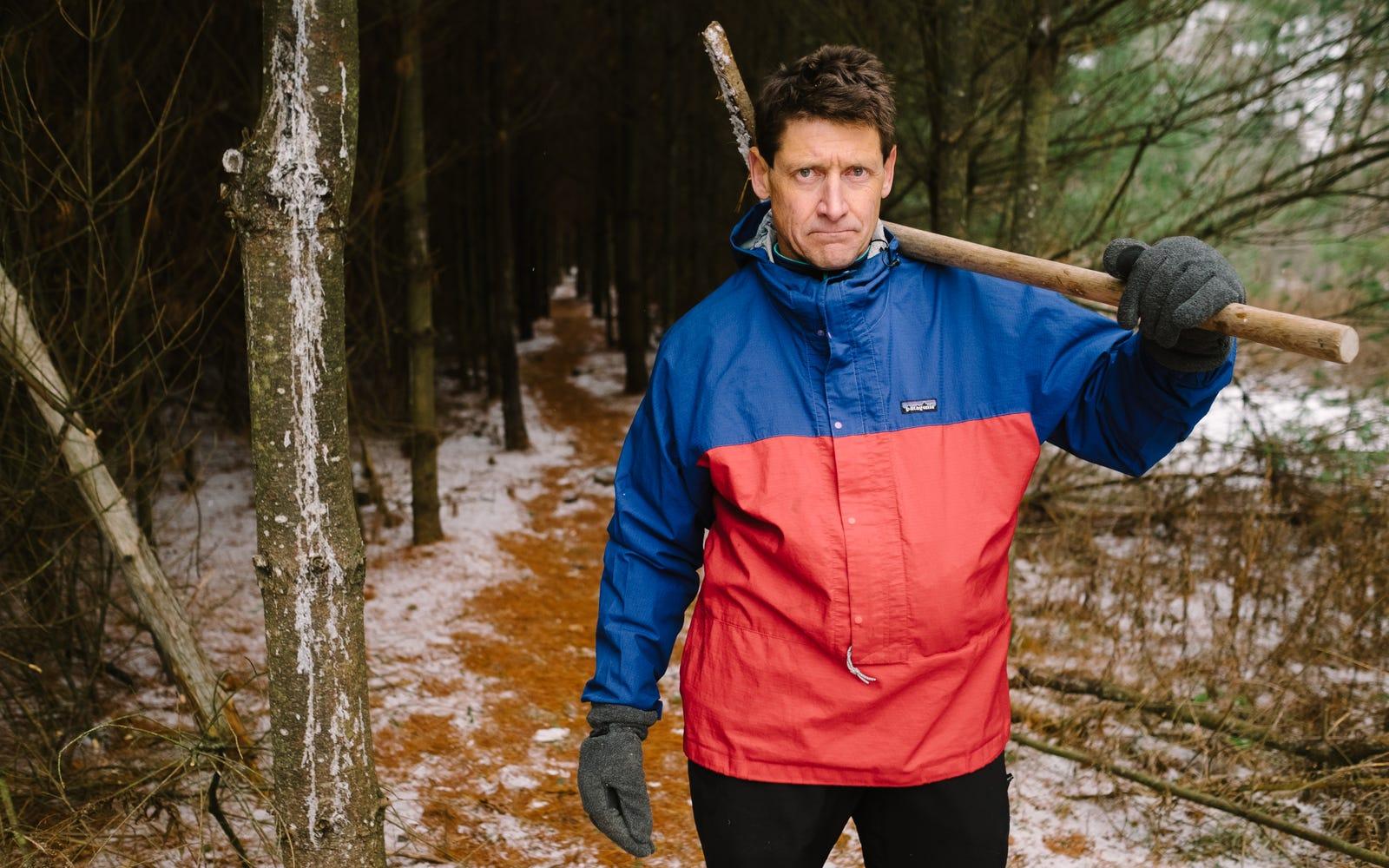 John Davis stands on the edge of Spirit Sanctuary's pine forest.