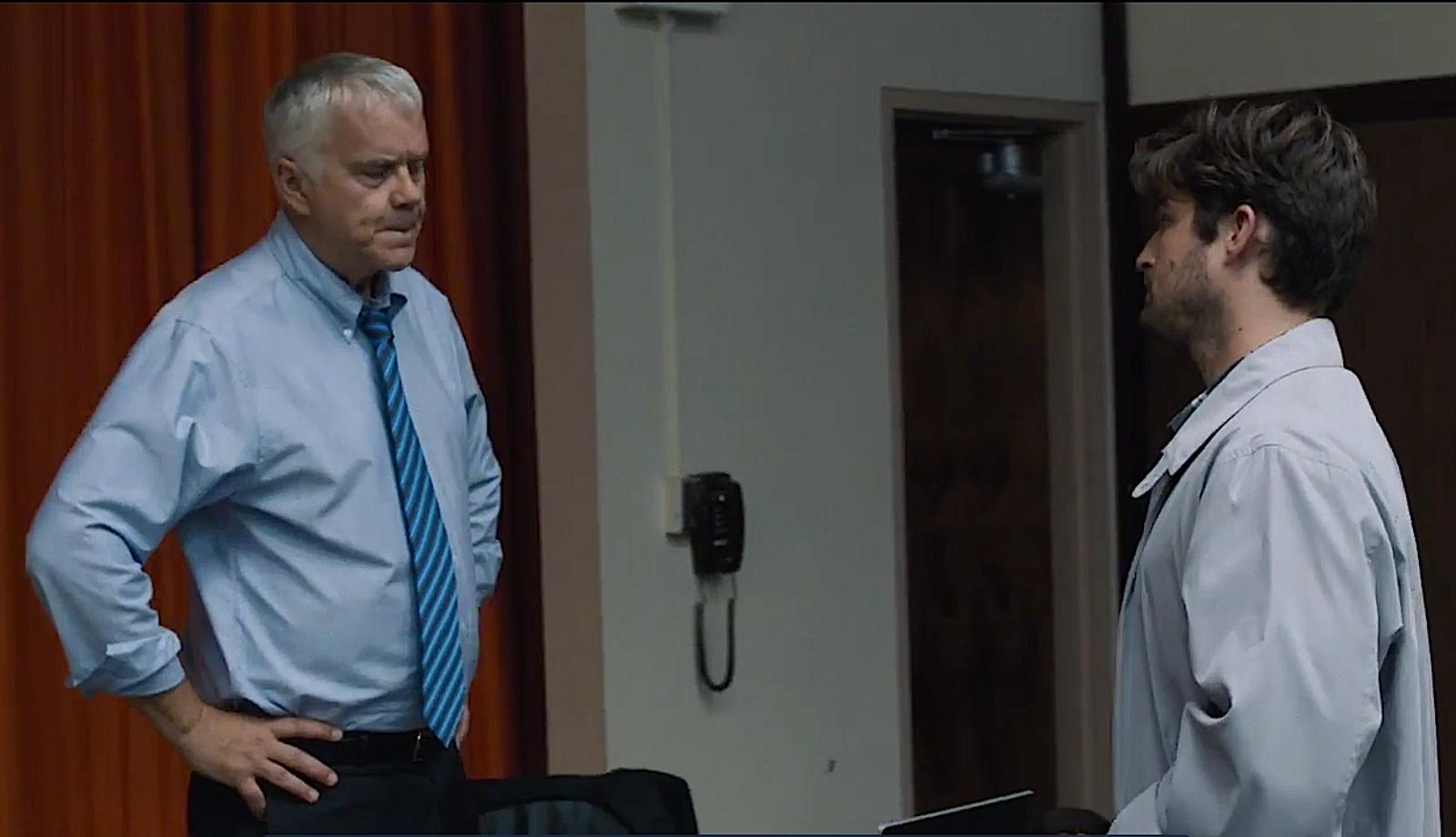 Greg frowns at TA. (Tim Robbins, Kevin Bigley/Screenshot: HBO)