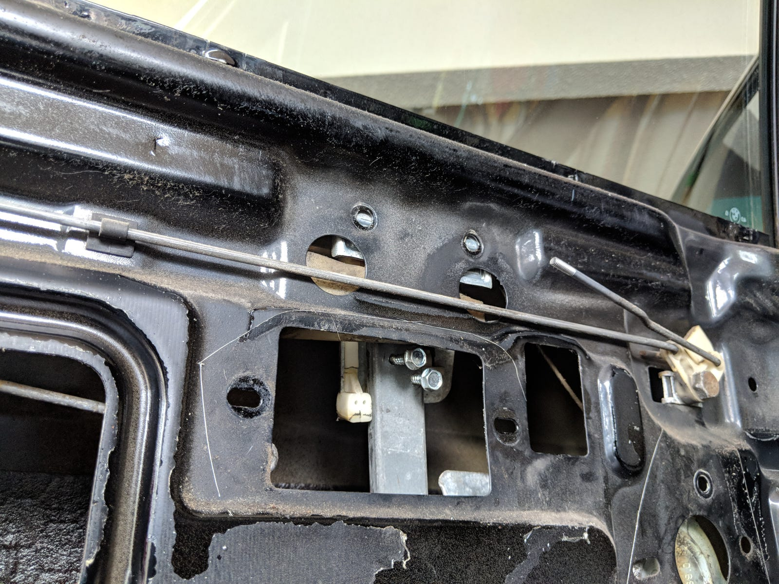 Those two screws had been driven into the old window regulator forcing the window in the up position. The previous owner's bodging continued.