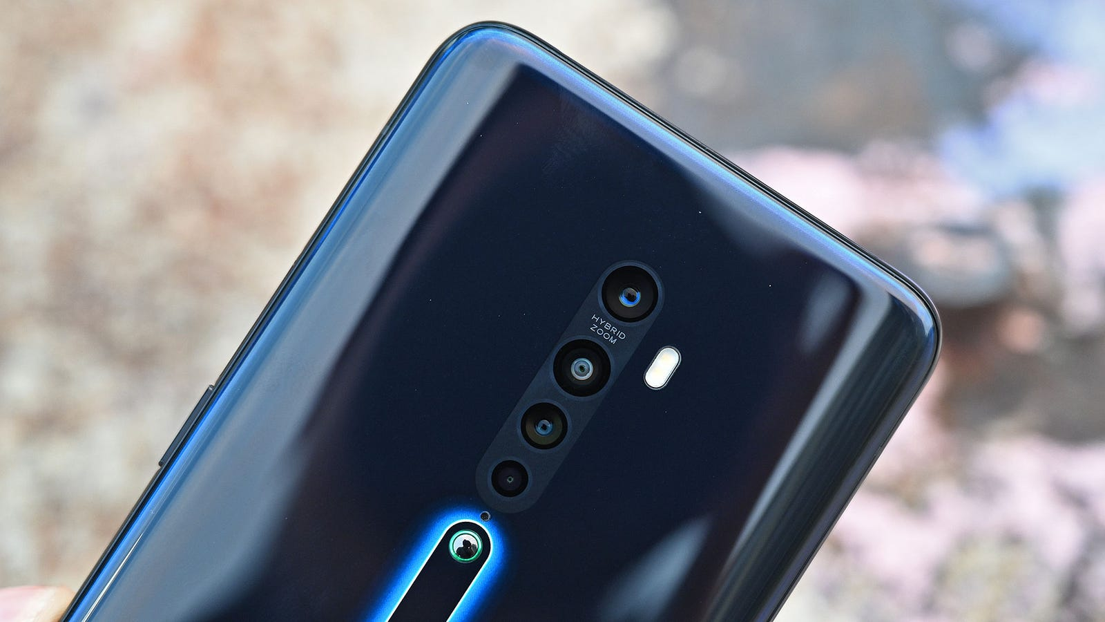 Illustration for article titled A Shark Fin and Ceramic Nipple Make the Oppo Reno 2 Wacky, Yet Sophisticated
