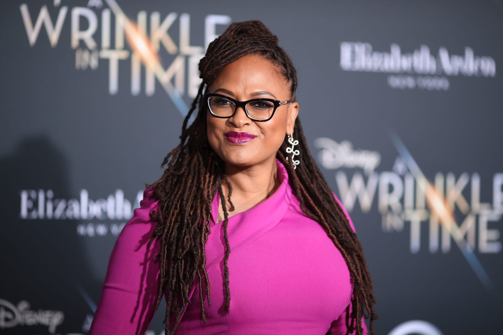 A Wrinkle in Time director Ava DuVernay, poised in pink (Christopher Polk/Getty Images)