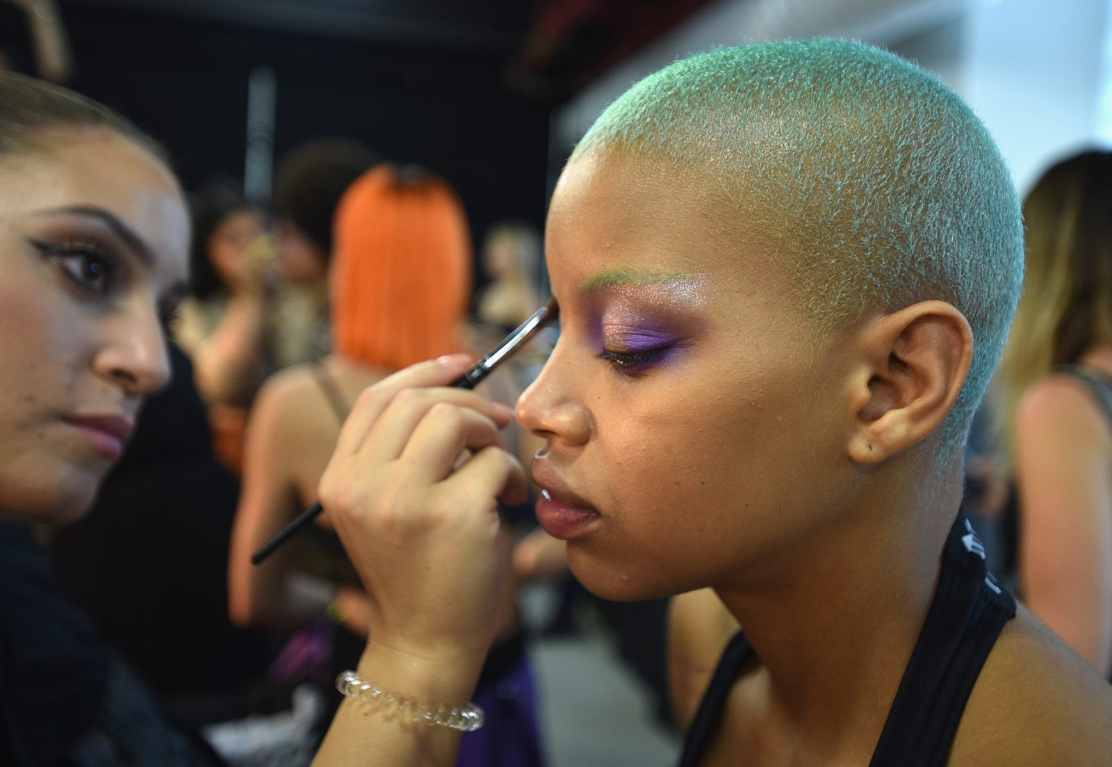 Slick Woods prepares backstage for the Savage X Fenty Fall/Winter 2018 fashion show during NYFW at the Brooklyn Navy Yard on September 12, 2018 in Brooklyn, NY.