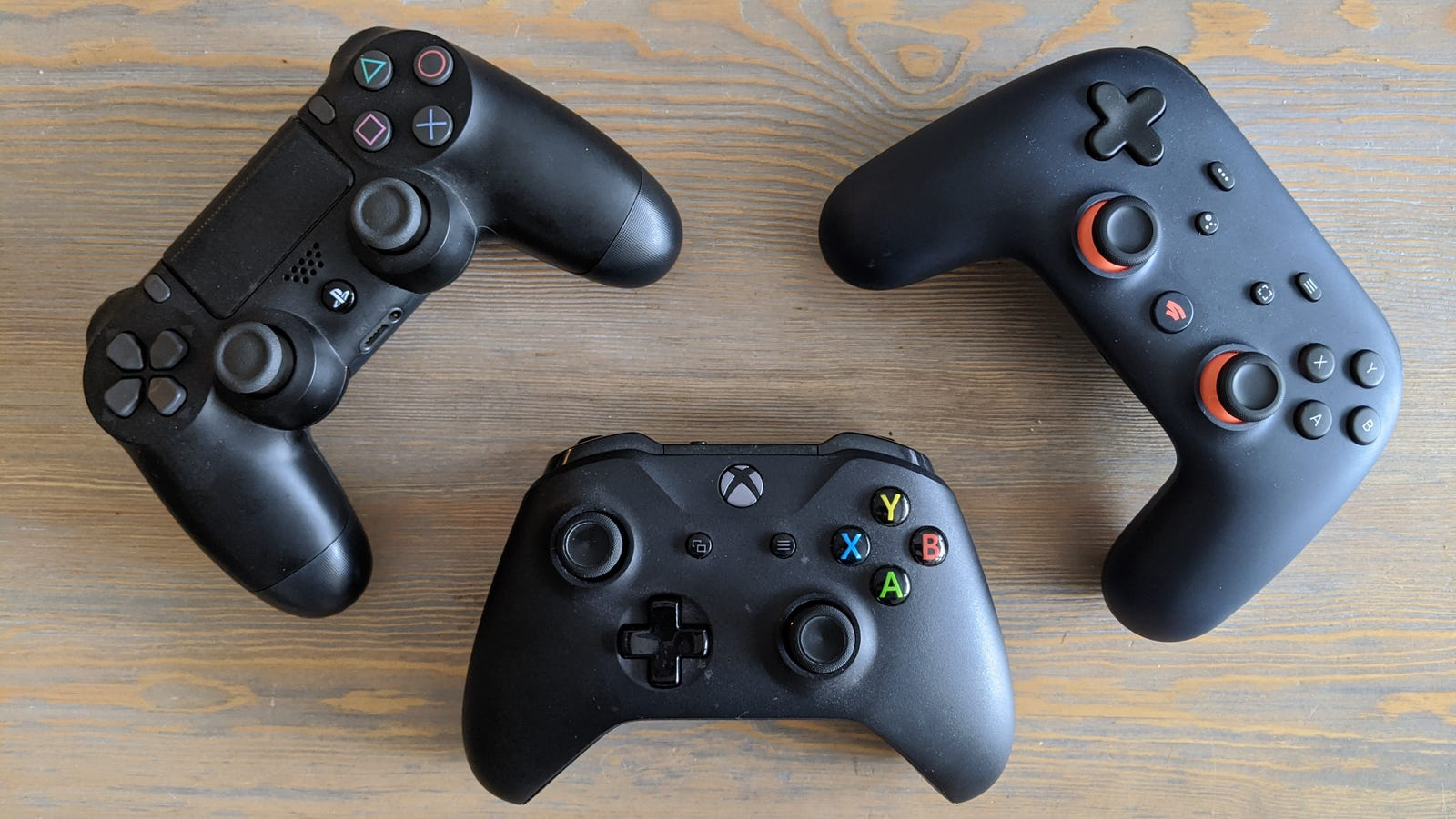 From left to right: PlayStation 4, Xbox One, and Google Stadia controllers.