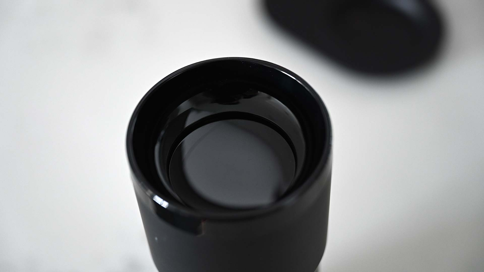 The Travel Mug's lid is surprisingly secure, but I still wouldn't just toss the thing in a bag if it's full of liquid.