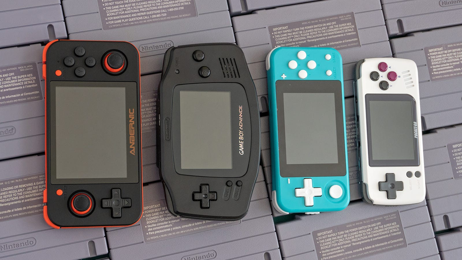 From left to right, a size comparison of the RG350, the Game Boy Advance, the Powkiddy Q90, and the PocketGo.