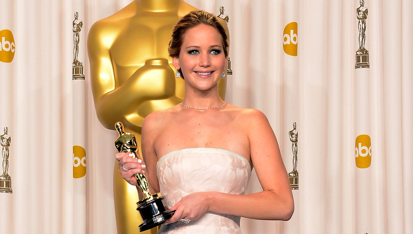 Actress Jennifer Lawrence is wearing a dress in this shot, but if she wasn't then it would be a MAJOR nip slip!