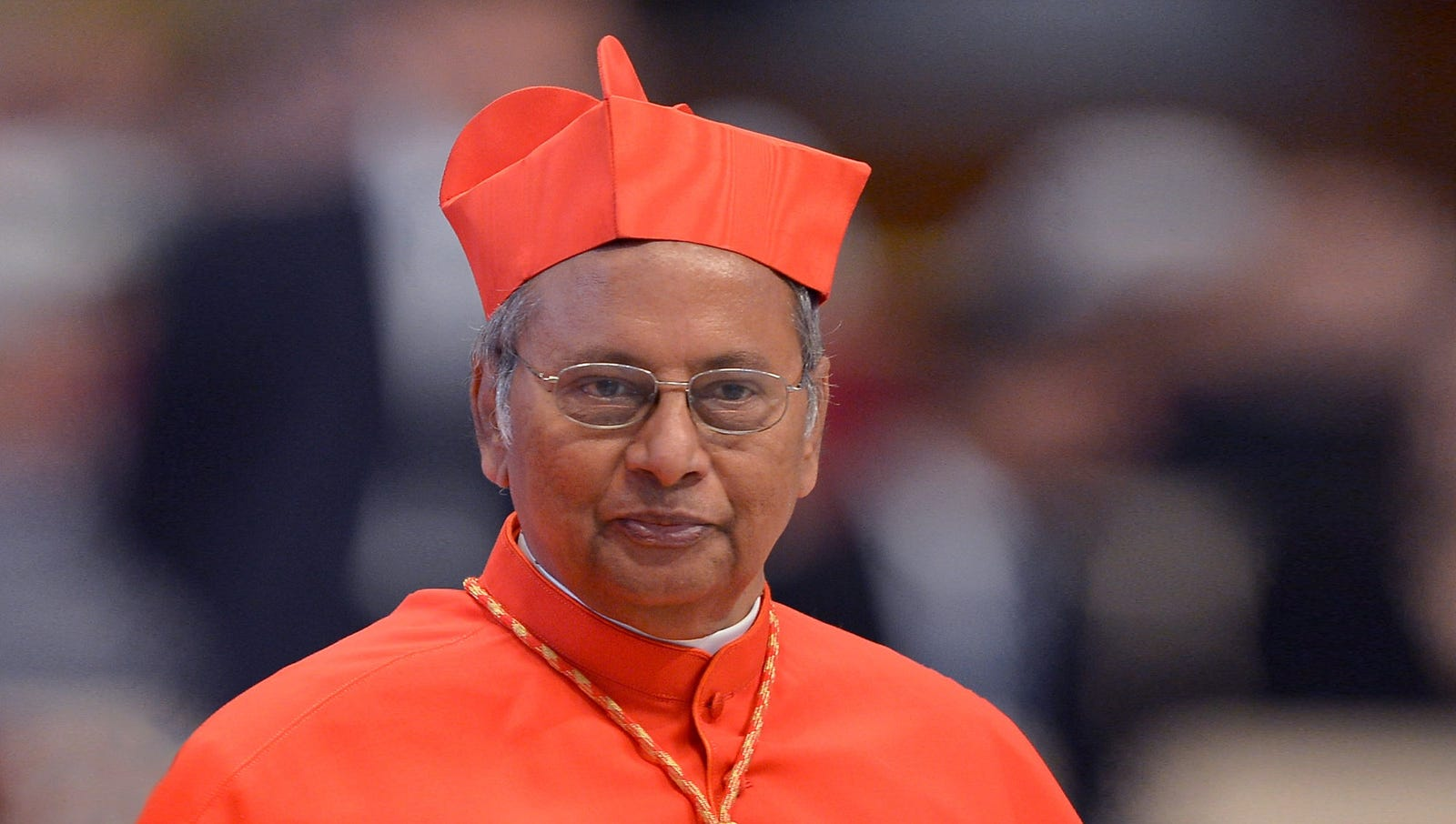 We love that Cardinal Ranjith took a chance on this look, but the execution is a major fail. The cape needs to be hemmed, the cross is dangling all over the place, and that boxy floor-length robe isn't doing his figure any favors.