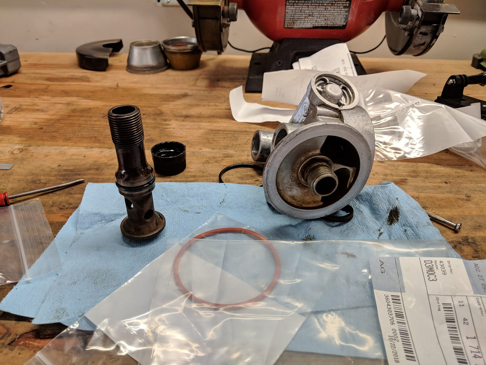 Oil filter tree and securing bolt receiving new o-rings.