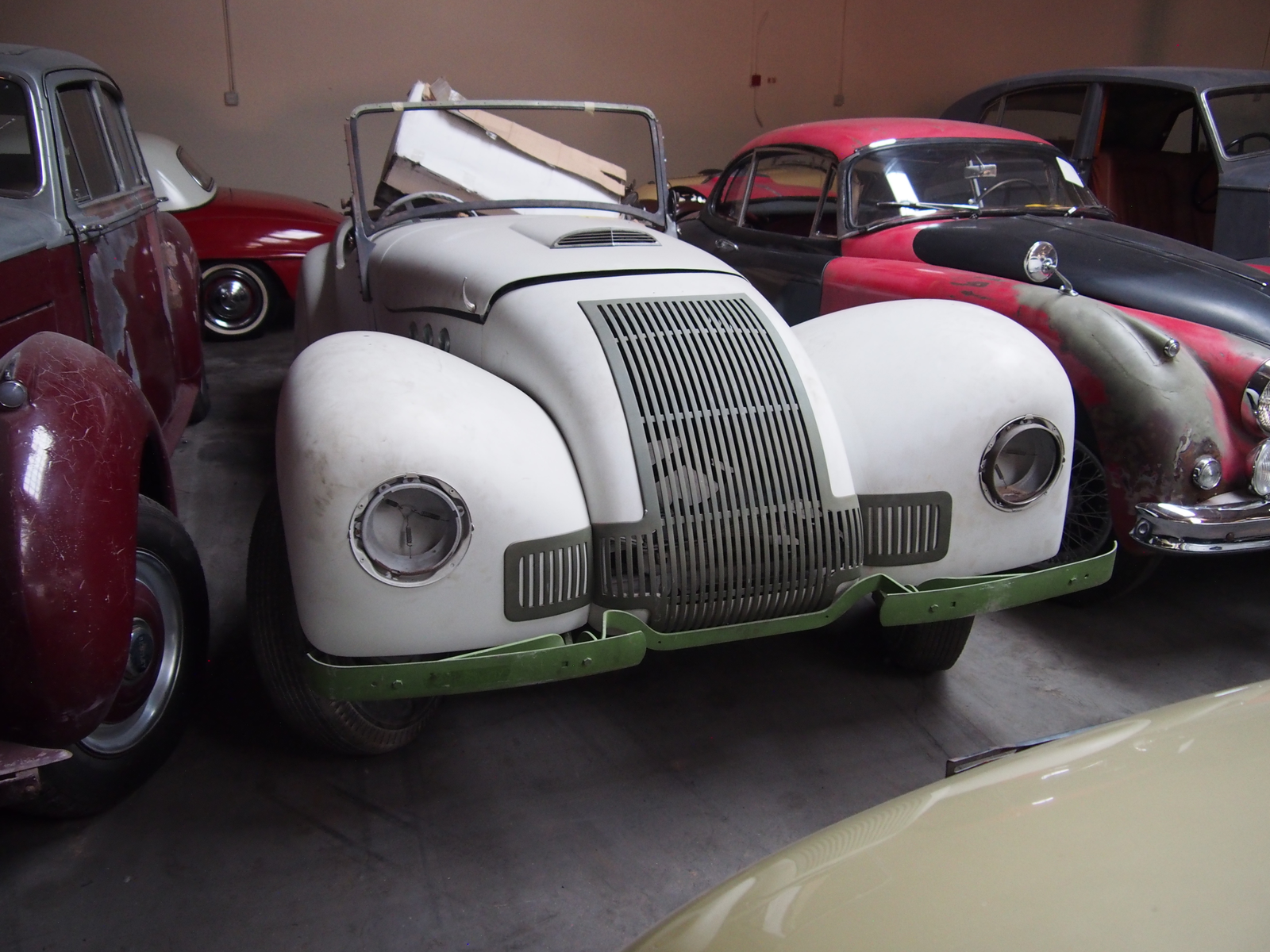 This isn't on their website, but I believe it's an Allard J1 which would make it an extremely rare car as Allard only built 12.  These could be had with a 3.6 or 3.9 liter Ford V8, so maybe the hood scoop means this has the bigger engine? Anyway, amazing car. I wonder where they found it.
