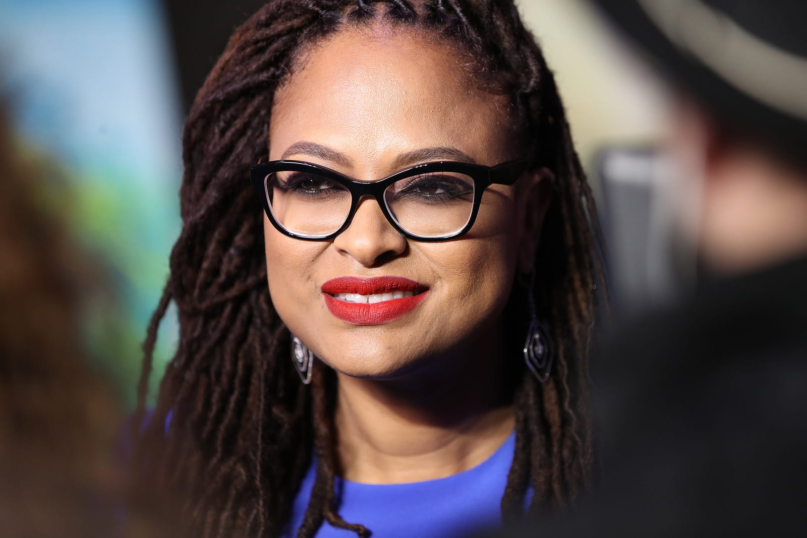 Ava DuVernay pairs her classic red lip with a brilliant blue. (Chris Jackson/Getty Images for Disney)