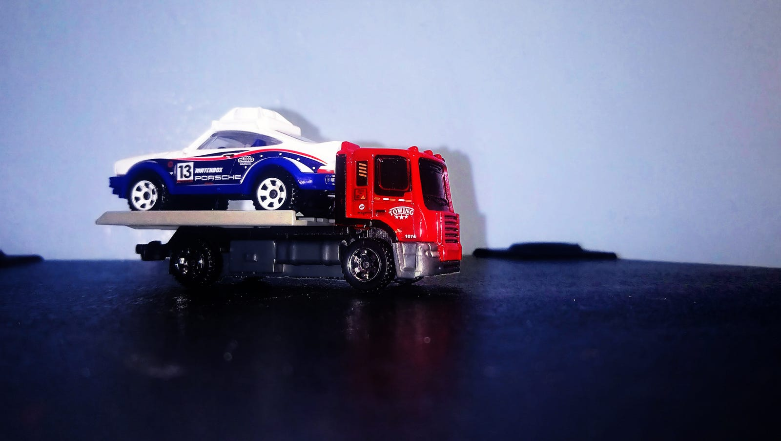 What a miracle! Both the Porsche and the flatbed towing lorry look great, though there are drawbacks as the next slides can attest.