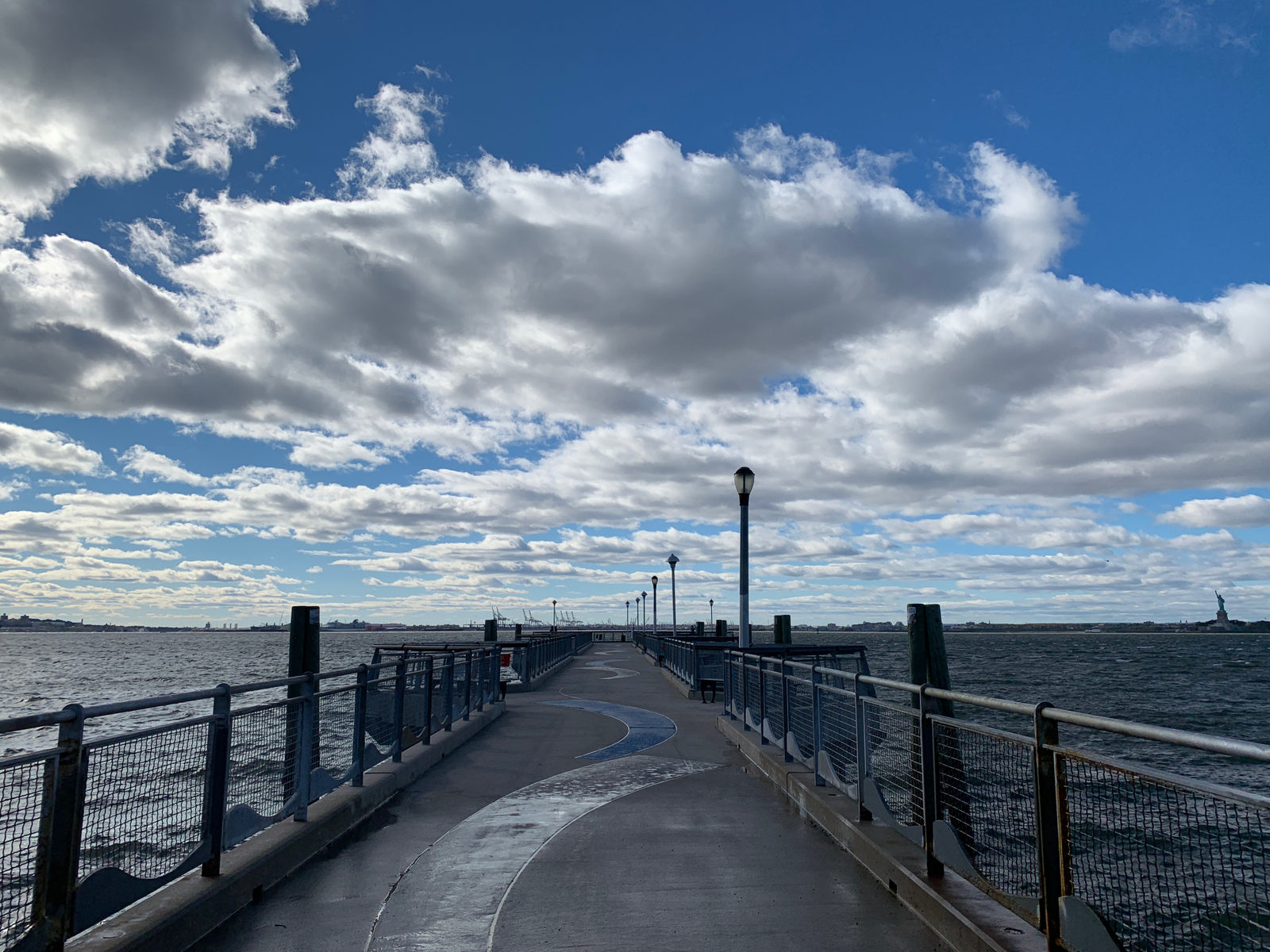 The iPhone XR. The slightly wider angle lens means you capture the Statue of Liberty off to the right. But also note just how much more detail there is in the clouds.