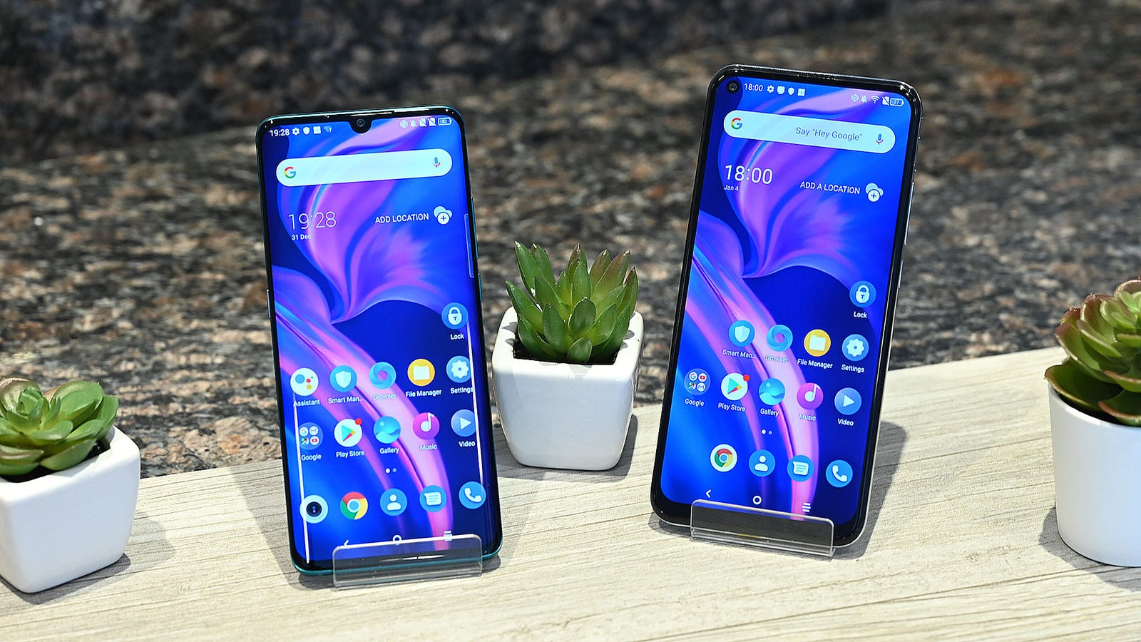 The TCL 10 Pro with its central notch and curved glass is on the left, while the TCL 10 5G is on the right.