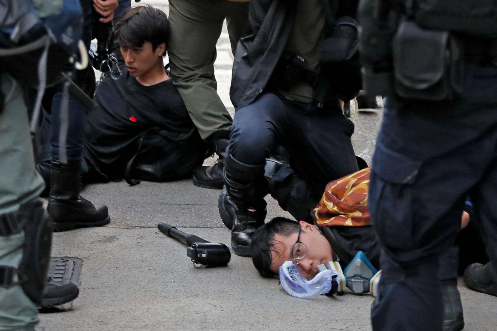 Protesters are detained by riot policemen during the anti-extradition bill protest in Hong Kong, Sunday, Aug. 11, 2019.