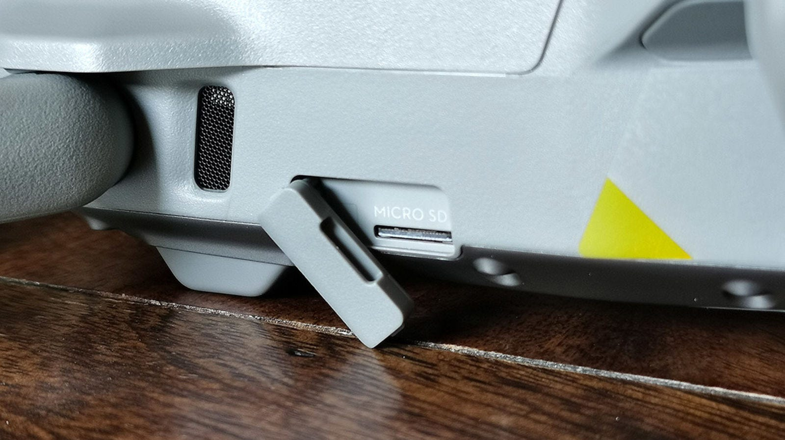 There are no sensors on the sides. This is a slot for the microSD cards. It can be used with cards of up to 256 GB.