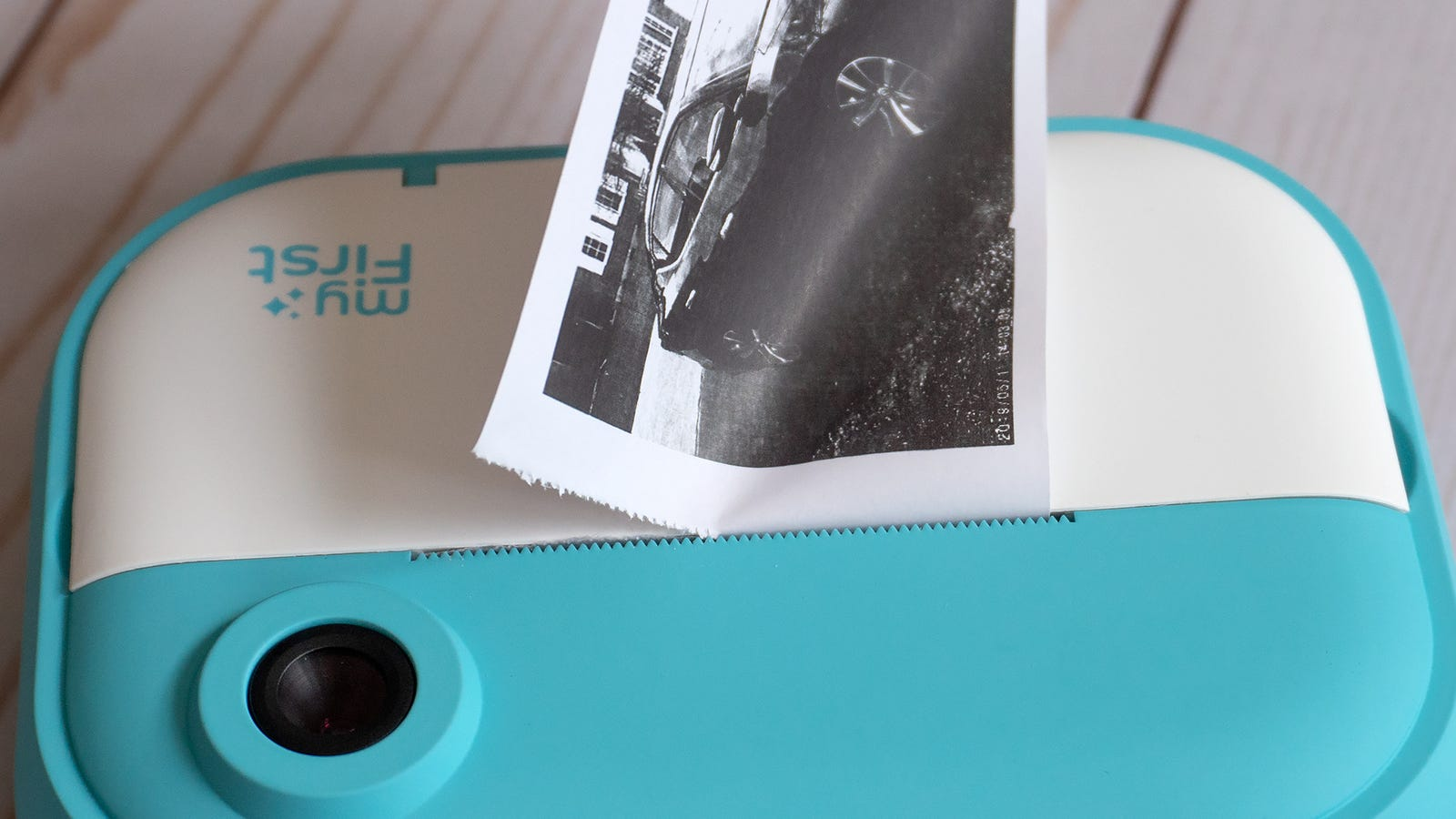 You can use a pair of scissors to separate a printed photo from the roll, but a set of serrated teeth work just as well for quickly tearing each print off.