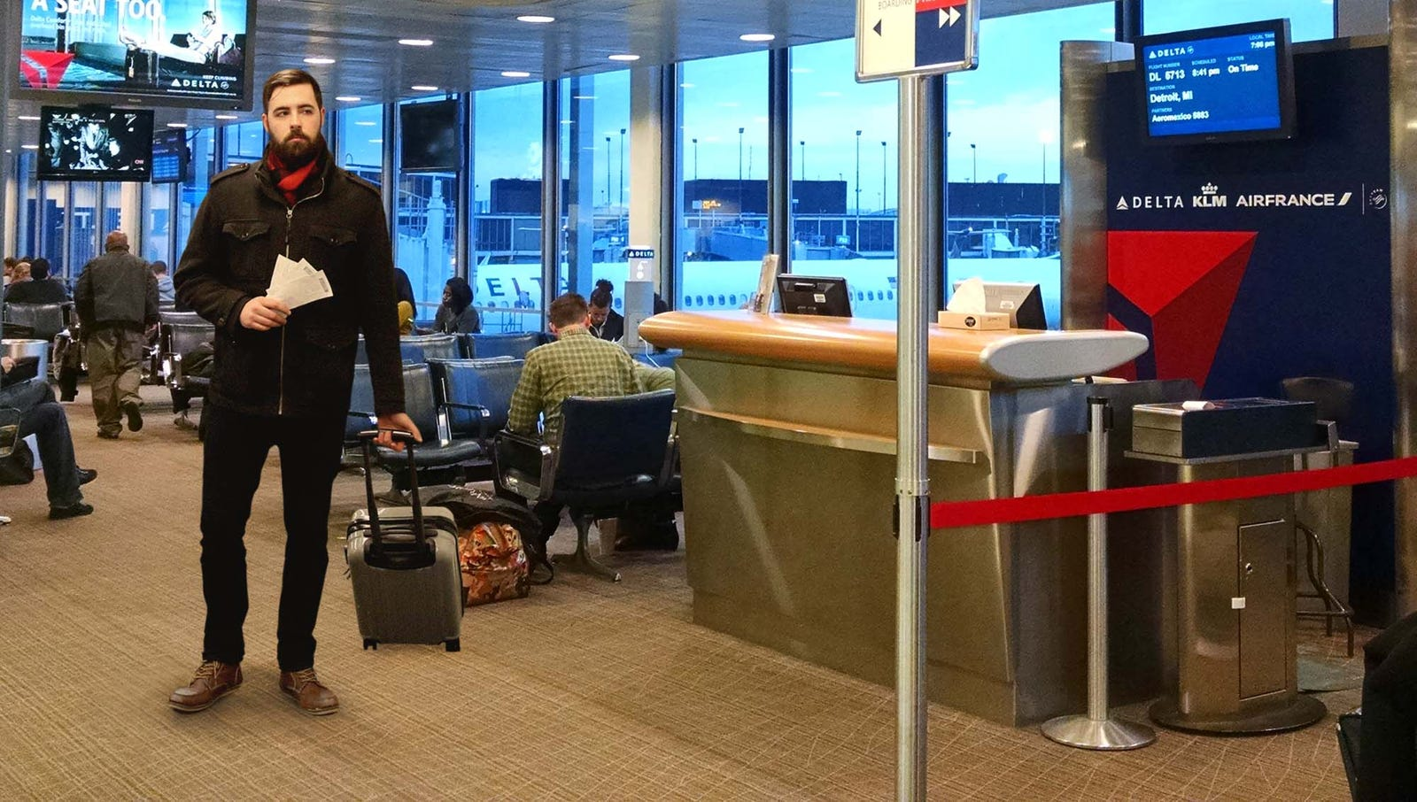 Man Prowling At Airport Gate Ready To Pounce Like Jungle Cat At First Sign Of Boarding