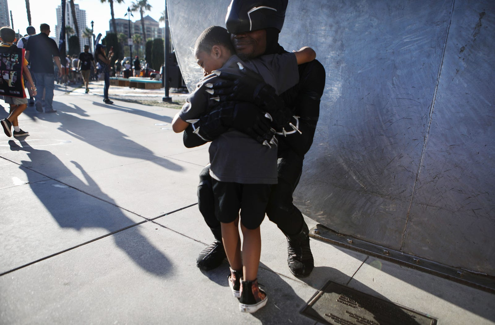 A boy hugs a cosplayer dressed as Black Panther outside San Diego Comic-Con on July 19, 2018 in San Diego, California.