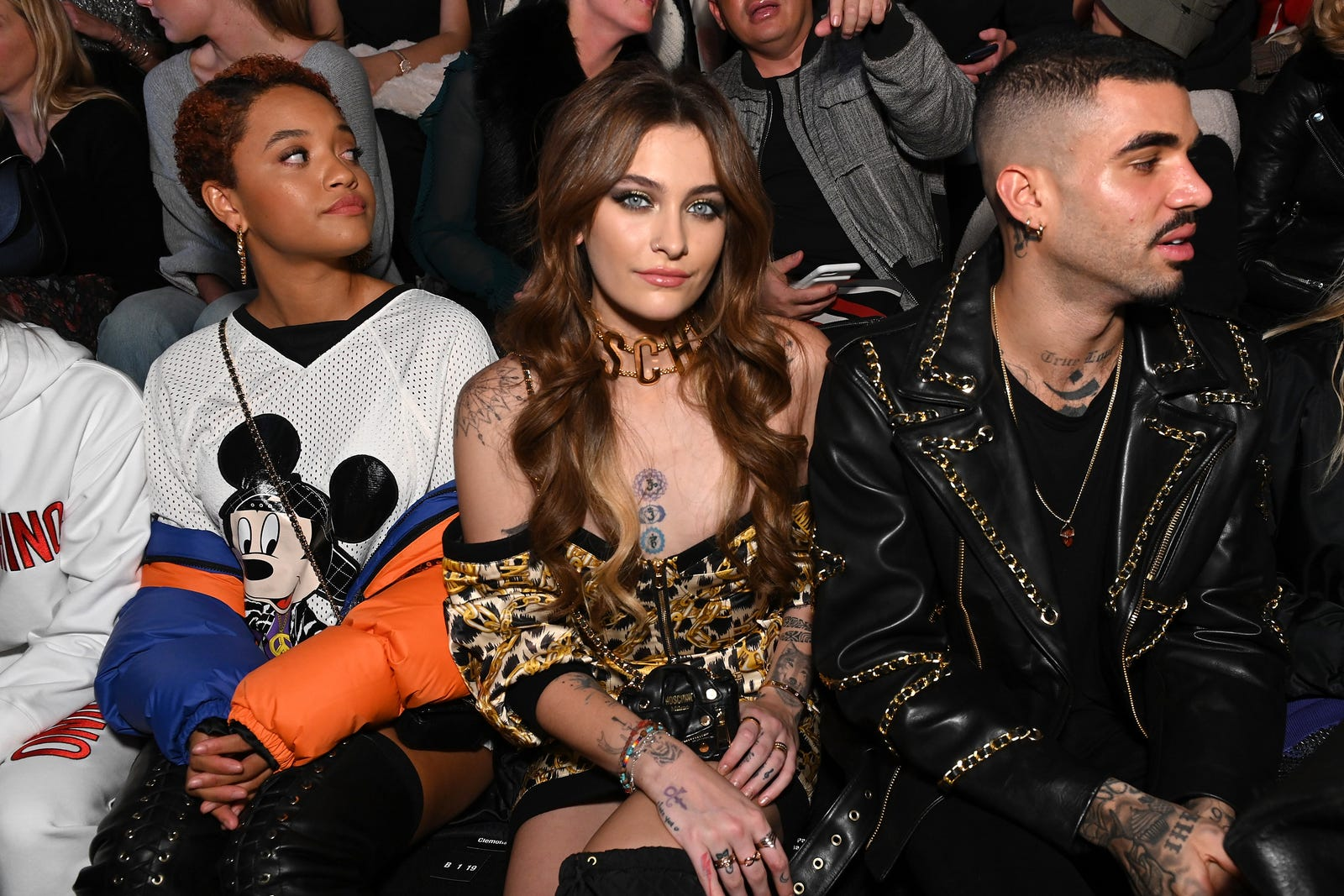 (l-r) Kiersey Clemons, Paris Jackson and Miles Ritchie attend the Moschino x H&M - Front Row at Pier 36 on October 24, 2018, in New York City.