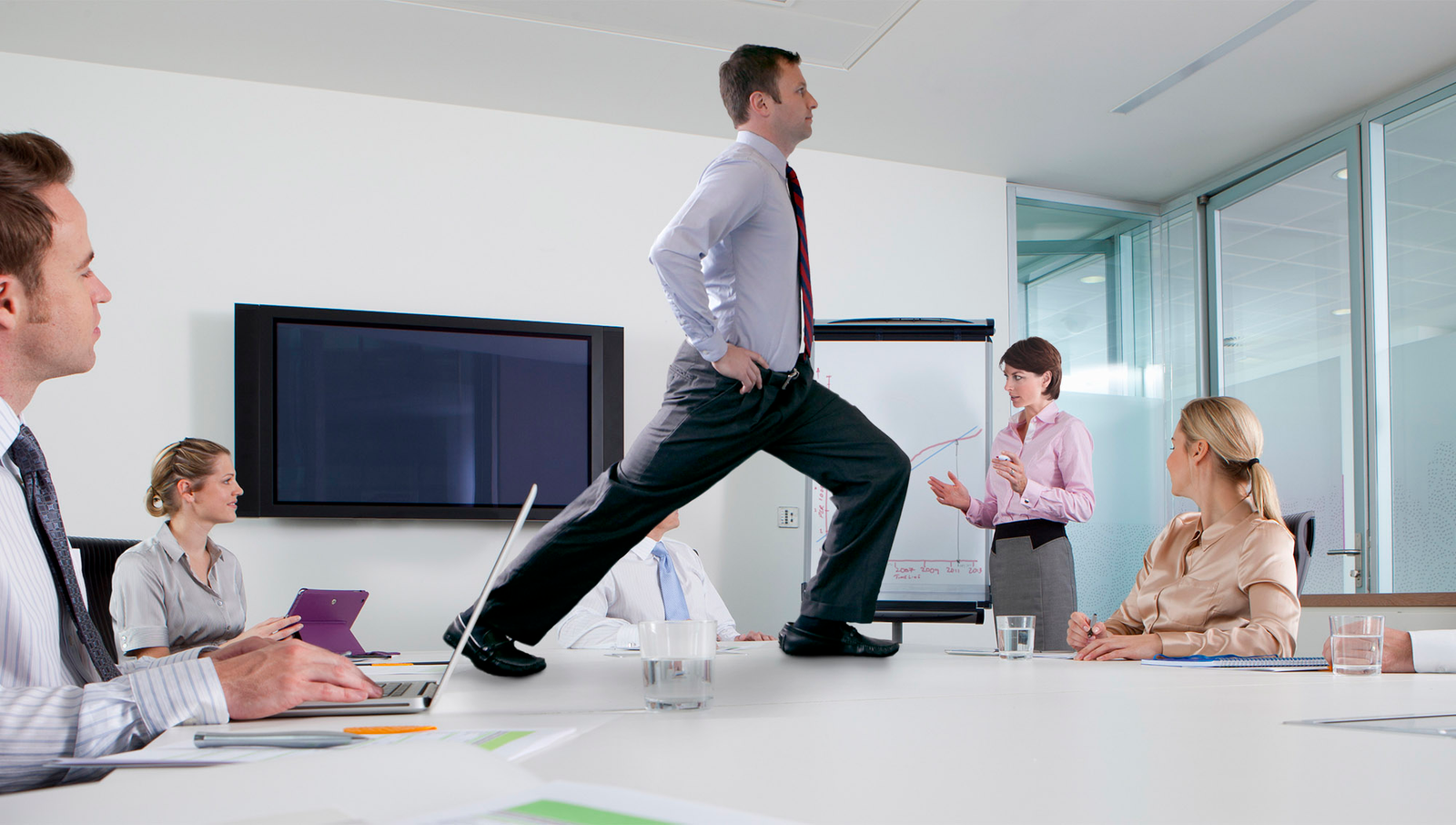 Finding time in your schedule to work out can be difficult, which is why performing a few easy exercises at the office can be the perfect way for a busy person to stay in shape. For example, sneak in a low-impact training session during a weekly budget meeting by doing a few sets of lunges.