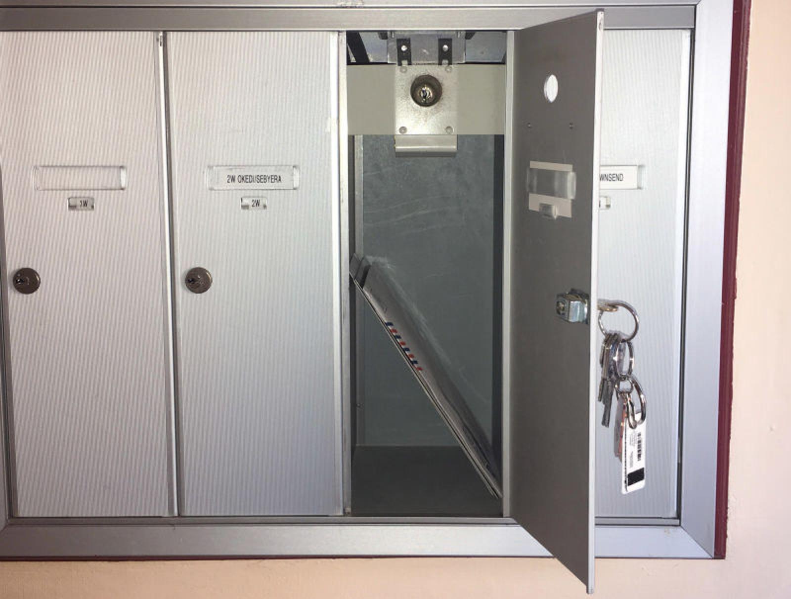 Junk Mail Locked Back Inside Letterbox Until Something More Important Delivered