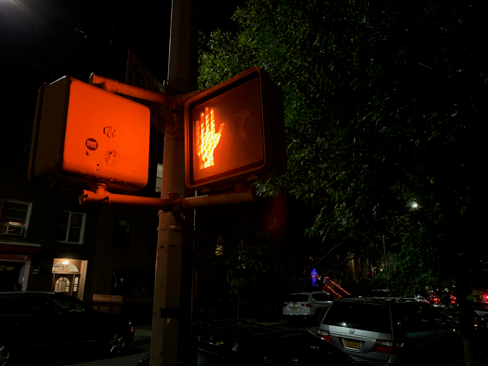 In this very dark night shot you can make out a lot more details in both the crossing sign and in the building entrance behind it.