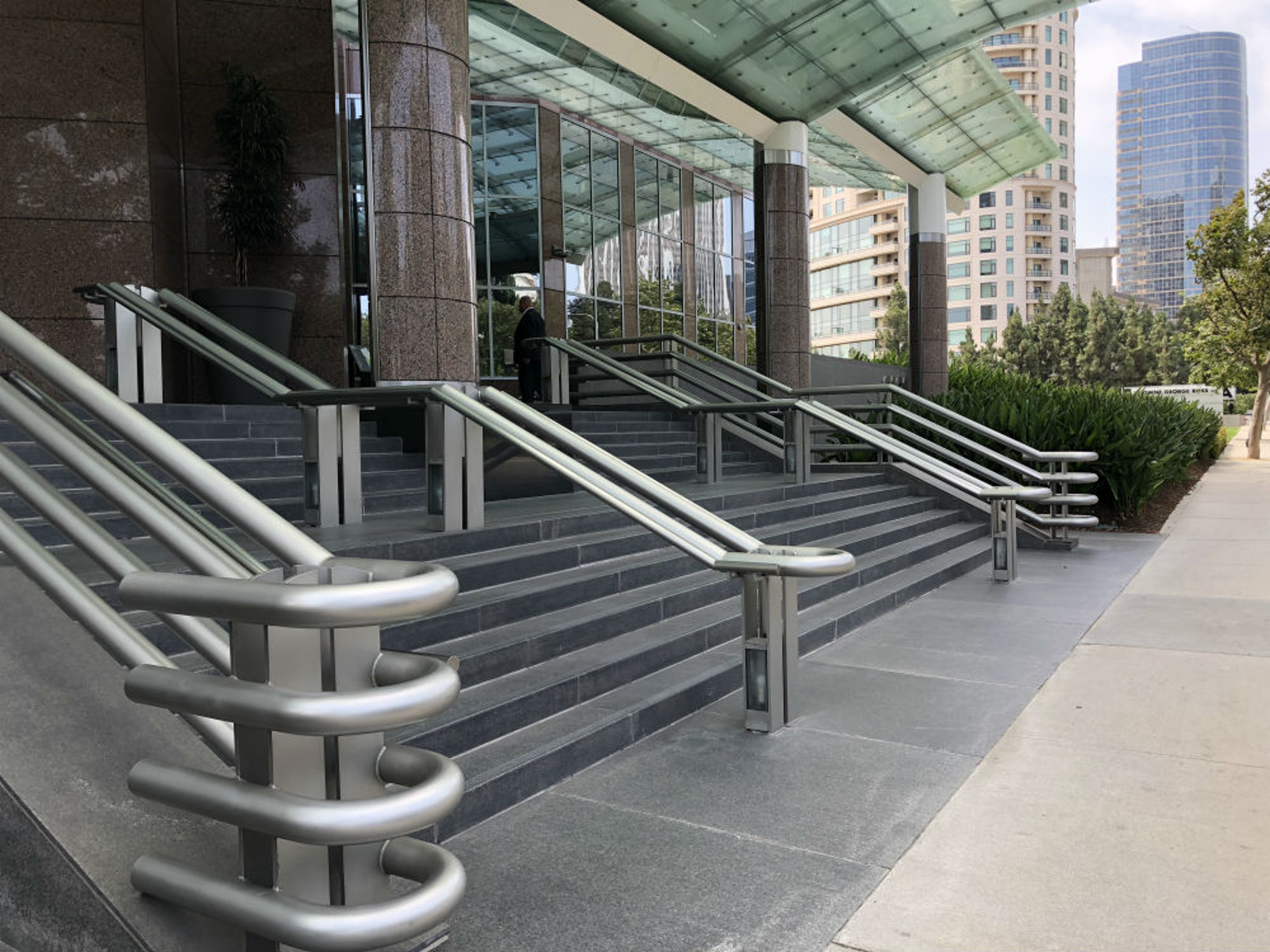 Four railings outside the building because the middle one was destroyed during filming.