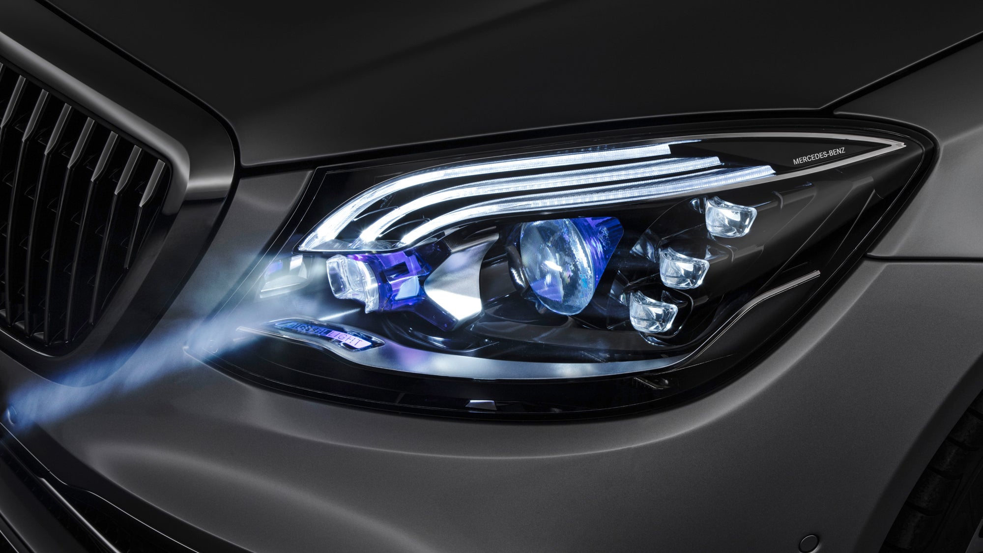 Mercedes Futuristic Headlights Shine Warning Symbols On The Road
